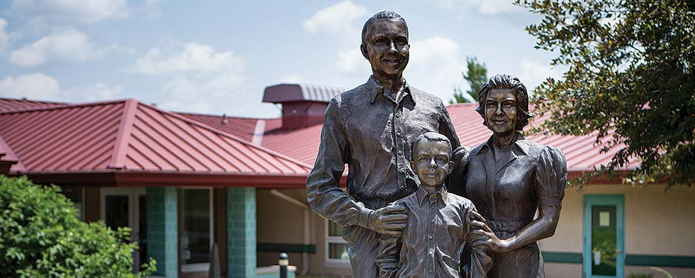 slide image of statue in front of ahrens family center