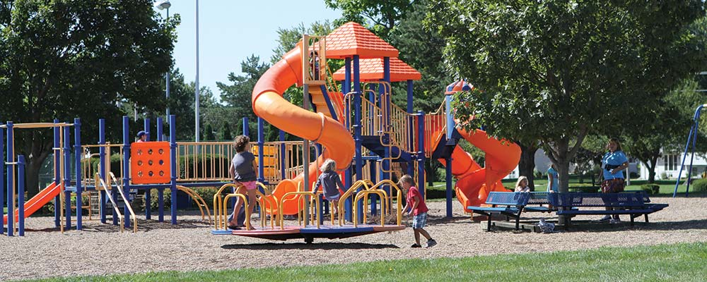 slide image of kids playing on playground at ahrens park