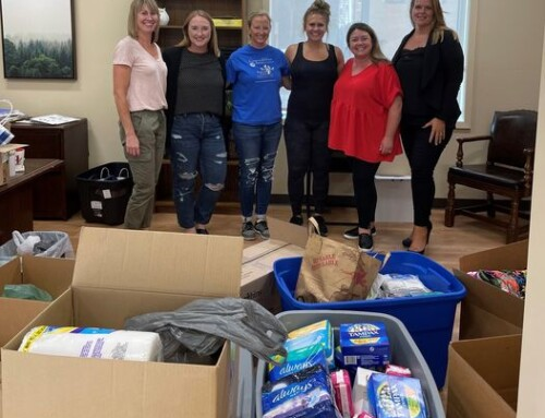 SHE Counts board gathers to distribute personal care items